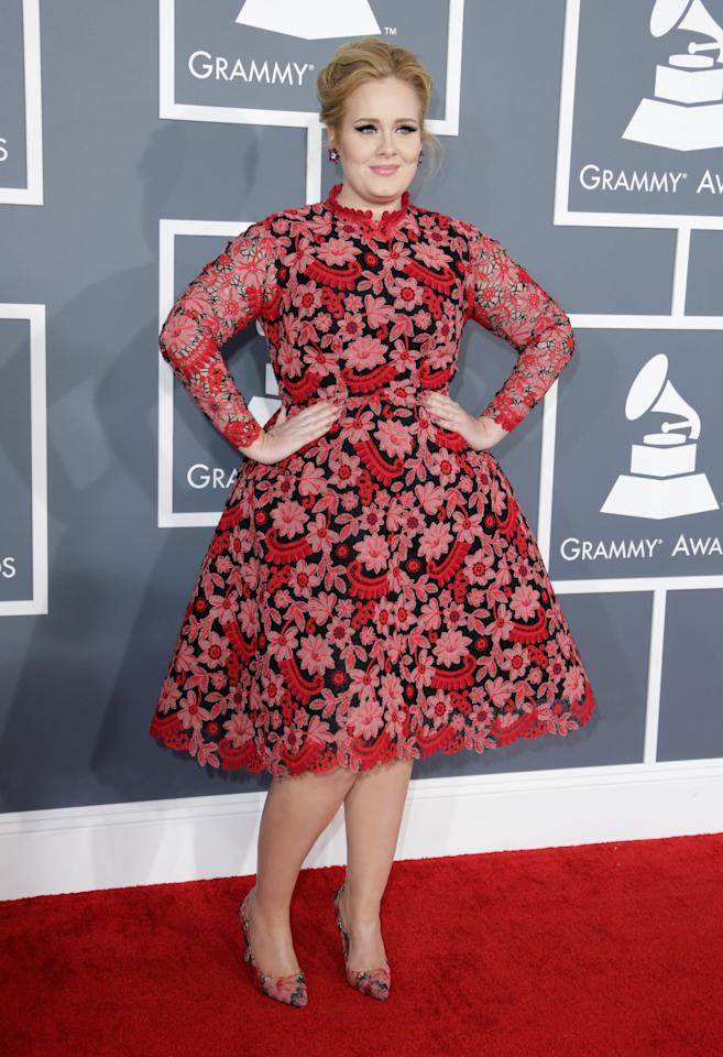 What a surprise to see Adele ditch black on the red carpet. She goes all matchy-matchy with a Valentino gown and shoes. We are totally loving this unexpected moment!