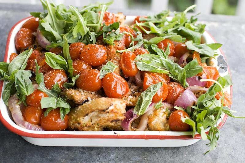 In this image taken on June 10, 2013, a grilled bread and tomato salad is shown in Concord, N.H. (AP Photo/Matthew Mead)