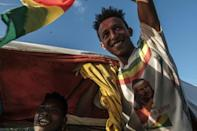 Celebrations: A man waves the Ethiopian imperial flag during an impromptu parade for freed opposition leaders in Alamata