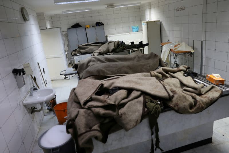 FILE PHOTO: Dead bodies are seen in a hospital following an attack on a military academy, in Tripoli