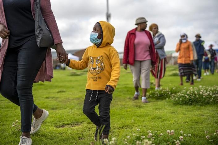 Residents from the Alexandra township in Johannesburg gather in a stadium to be tested for COVID-19 Monday, April 26, 2020. South Africa will began a phased easing of its strict lockdown measures on May 1, although its confirmed cases of coronavirus continue to increase. (AP Photo/Jerome Delay)