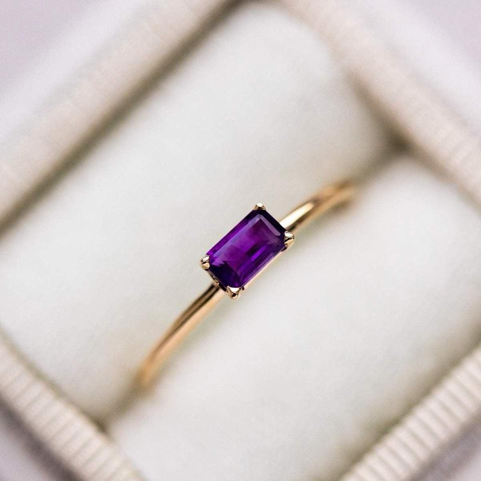 """<p>Complete with a thin gold band, this <a href=""""https://www.popsugar.com/buy/Amethyst-Octagon-Ring-531758?p_name=Amethyst%20Octagon%20Ring&retailer=localeclectic.com&pid=531758&price=280&evar1=fab%3Aus&evar9=47015200&evar98=https%3A%2F%2Fwww.popsugar.com%2Ffashion%2Fphoto-gallery%2F47015200%2Fimage%2F47015962%2FColored-Stones-Amethyst-Octagon-Ring&list1=shopping%2Cjewelry%2Crings%2Cengagement%20rings&prop13=mobile&pdata=1"""" rel=""""nofollow noopener"""" class=""""link rapid-noclick-resp"""" target=""""_blank"""" data-ylk=""""slk:Amethyst Octagon Ring"""">Amethyst Octagon Ring</a> ($280) is sure to stand out against existing accessories.</p>"""