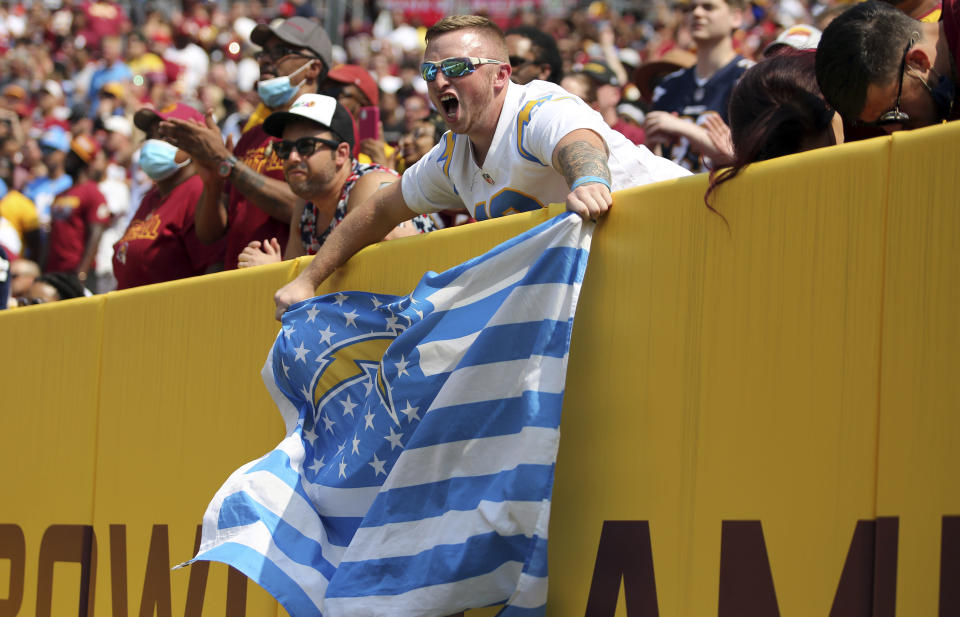Los Angeles Chargers fans celebrate during an NFL football game against the Washington Football Team, Sunday, Sept. 12, 2021 in Landover, Md. (AP Photo/Daniel Kucin Jr.)