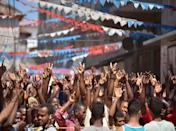 Supporters of the Civic United Front (CUF) party gather outside the CUF headquarters in Zanzibar on October 26, 2015 as the party's presidential candidate declared victory in the polls (AFP Photo/Tony Karumba)