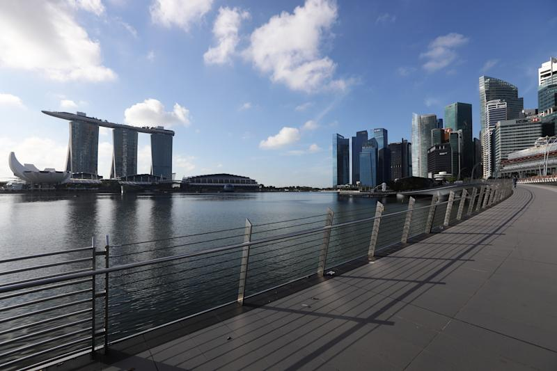SINGAPORE - MARCH 24: A general view of an empty attraction at a normally busy Jubilee Bridge, Marina Bay Sands, the ArtSicience Museum and the Singapore skyline on March 24, 2020 in Singapore. Singapore will not allow short term visitors to enter or transit through the country from March 24 to contain the spread of the imported COVID-19 infection. (Photo by Suhaimi Abdullah/Getty Images)