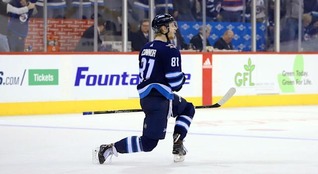 "Kyle Connor #81 of the <a class=""link rapid-noclick-resp"" href=""/nhl/teams/wpg/"" data-ylk=""slk:Winnipeg Jets"">Winnipeg Jets</a> celebrates after scoring the overtime winner against the <a class=""link rapid-noclick-resp"" href=""/nhl/teams/los/"" data-ylk=""slk:Los Angeles Kings"">Los Angeles Kings</a>. (Darcy Finley/NHLI via Getty Images)"