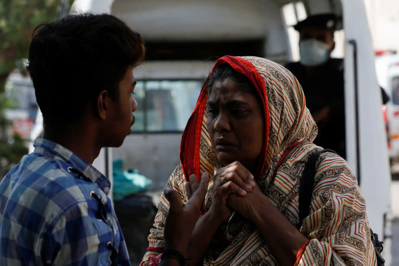Woman mourns the death of a relative, who was killed in a plane crash, outside a morgue in Karachi