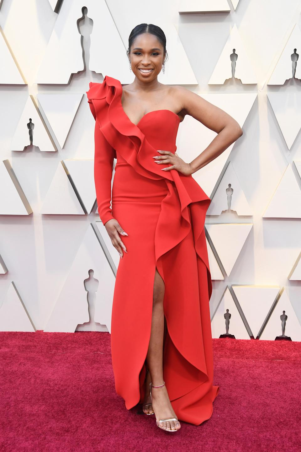 <p>The Oscar winner and performer at this year's ceremony wowed in a red one-shoulder gown by Elie Saab. (Image via Getty Images) </p>
