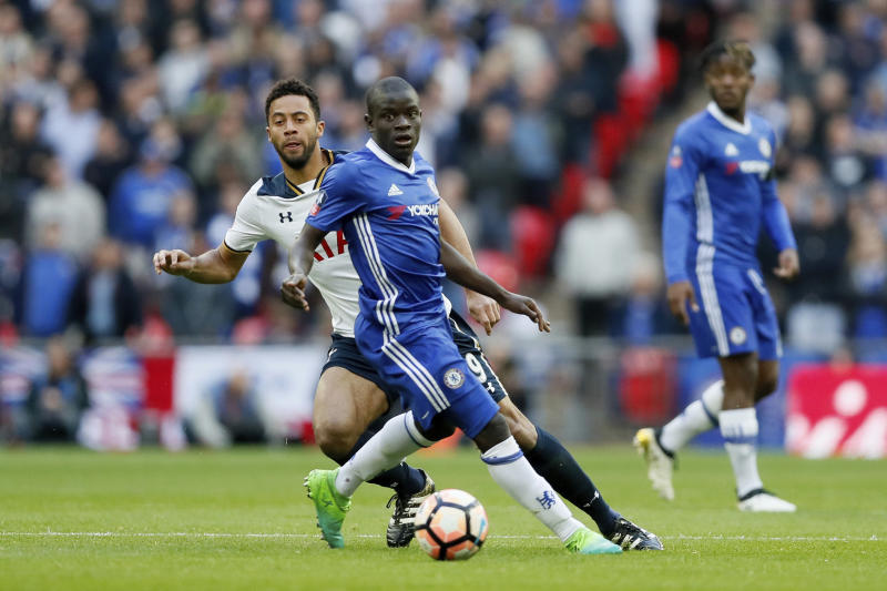 Chelsea's N'Golo Kante, center, competes for the ball with Tottenham Hotspur's Mousa Dembele, left, during the English FA Cup semifinal soccer match between Chelsea and Tottenham Hotspur at Wembley stadium in London, Saturday, April 22, 2017. (AP Photo/Kirsty Wigglesworth)