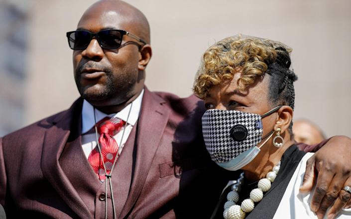 Gwen Carr, Eric Garner's mother, stands with Philonise Floyd outside the courthouse - Reuters