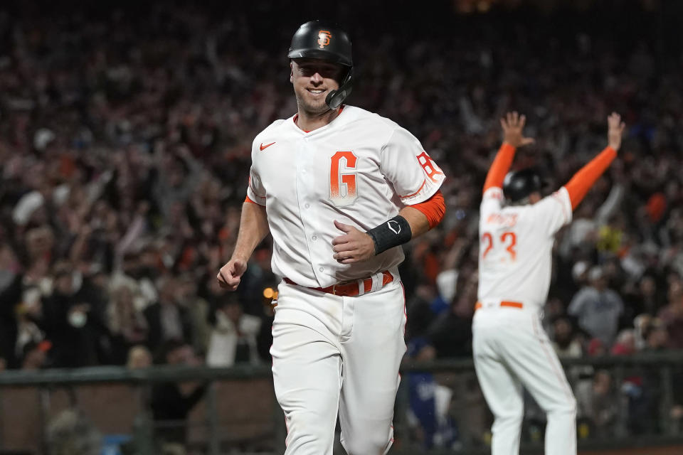 San Francisco Giants' Buster Posey runs home to score against the Los Angeles Dodgers during the eighth inning of a baseball game in San Francisco, Tuesday, July 27, 2021. (AP Photo/Jeff Chiu)