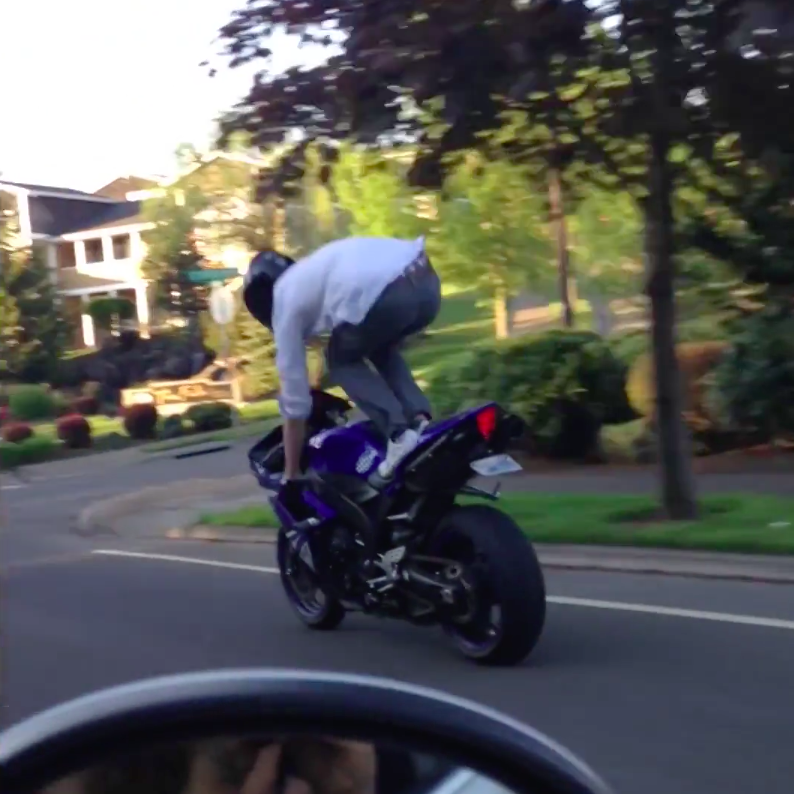 Note to self: Don't stand on a motorbike. Photo: Storyful