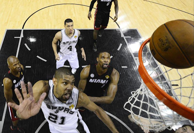 San Antonio Spurs' Tim Duncan shoots against Miami Heat during the second half at Game 5 of the NBA Finals basketball series, Sunday, June 16, 2013, in San Antonio. The Spurs won 114-104. (AP Photo/John G. Mabanglo, Pool)
