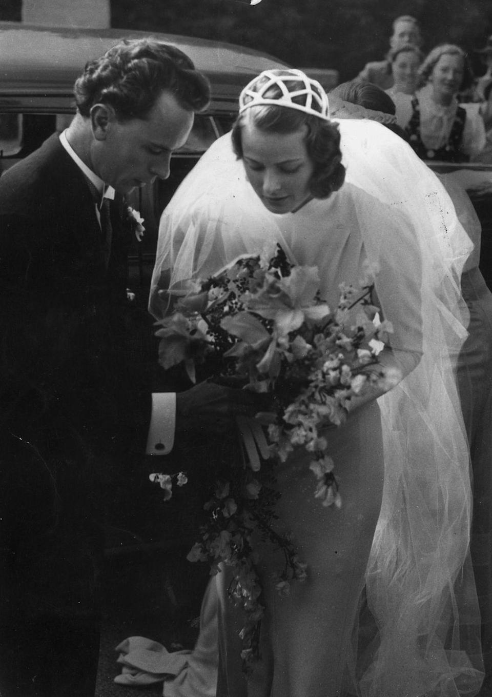 <p>Swedish actress Ingrid Bergman wore a high neck silk gown and a beaded cap with a veil when she married Swedish neurosurgeon, Petter Lindstrom, in 1937. </p>