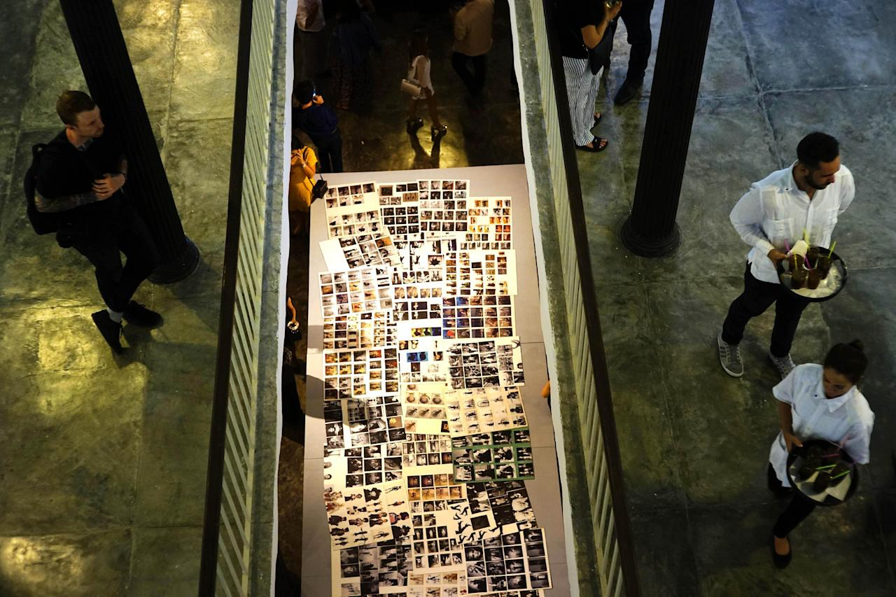 """People attend the Karl Lagerfeld exhibition """"Work in Progress"""" in Havana, Cuba,Sunday, May 1, 2016. After Lagerfeld, Chanel will present a fashion show with the collection """"Cruise"""" next May 3 in Havana. (AP Photo/Ramon Espinosa)"""