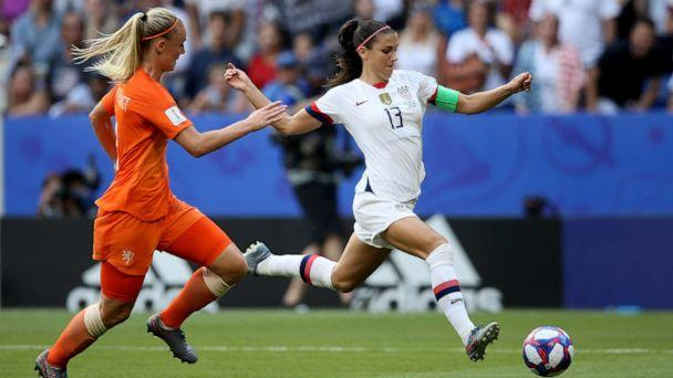 PHOTO: Alex Morgan, right, fights for the ball with Netherlands' Stefanie Van Der Gragt during the Women's World Cup final soccer match between US and The Netherlands at the Stade de Lyon in Decines, outside Lyon, France, July 7, 2019. (David Vincent/AP)