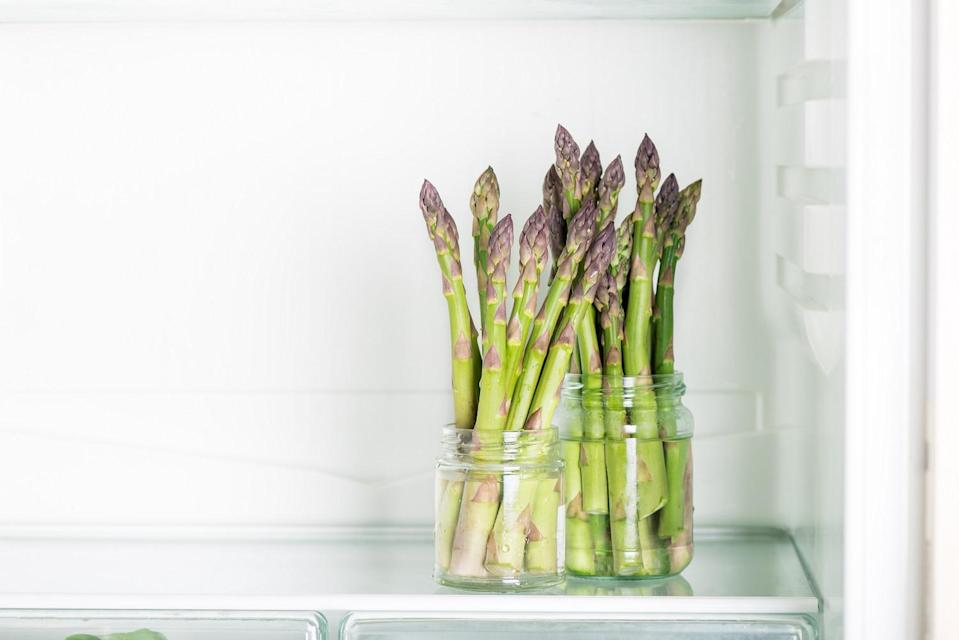 <p>Think of your greens like you would a bouquet of flowers. To keep vegetables like asparagus and scallions fresh, trim the bottoms and stand them upright in a jar with an inch or two of water. Cover the tips with a plastic bag so they don't pick up any strange fridge odors.</p>