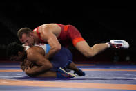 United States' David Morris Taylor III, top, and India's Deepak Punia compete in the men's 86kg Freestyle semifinal wrestling match at the 2020 Summer Olympics, Wednesday, Aug. 4, 2021, in Chiba, Japan. (AP Photo/Aaron Favila)
