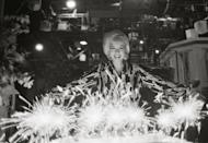 """<p>""""A huge birthday cake was brought in with sparklers for candles, and Marilyn posed behind it looking joyful and appreciative."""" </p>"""