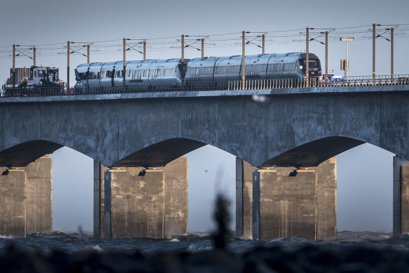 A view of the scene after a train accident on the Great Belt Bridge in Nyborg, Denmark, Wednesday, Jan. 2, 2019. A Danish passenger train apparently hit falling cargo from a passing freight train Wednesday, an accident that killed six people and injured 16 others as it crossed a bridge linking the country's islands, authorities said. Authorities said the trains were going past each other in opposite directions. Aerial TV footage showed one side of front of the passenger train had been ripped open. (Mads Claus Rasmussen/Ritzau Scanpix via AP)