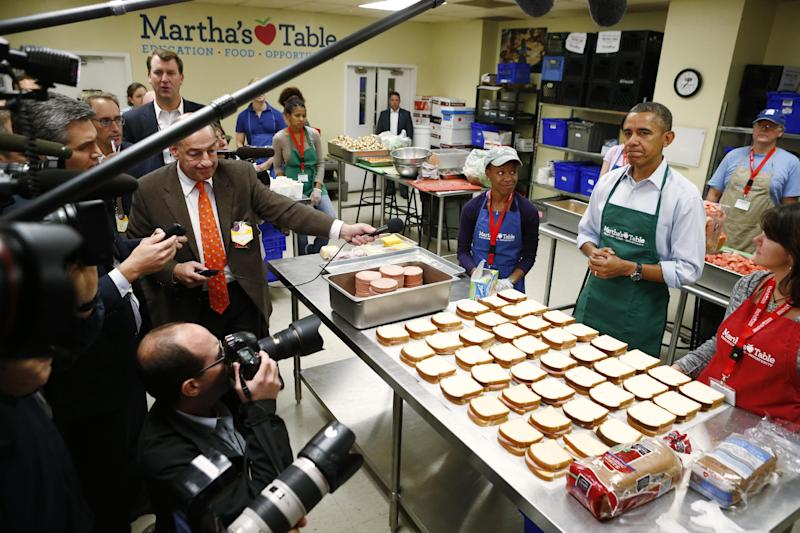 President Barack Obama speaks to reporters as he visits Martha's Table, which prepares meals for the poor and where furloughed federal employees are volunteering, in Washington, Monday, Oct. 14, 2013. President Obama spoke about the government shutdown and the looming debt ceiling during remarks to reporters during his visit. (AP Photo/Charles Dharapak)