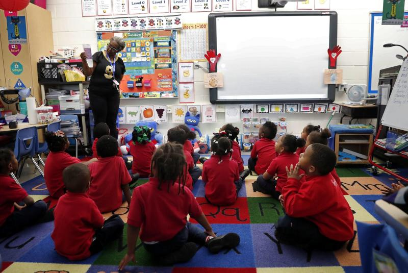A teacher leads a pre-kindergarten class.