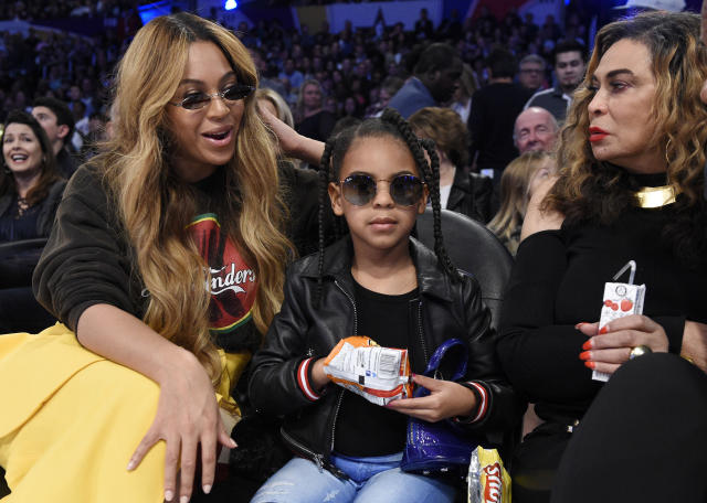 Beyoncé with her daughter Blue Ivy Carter and her mother, Tina Knowles Lawson, at the NBA All-Star Game in Los Angeles on Feb. 18, 2018. (AP Photo/Chris Pizzello)