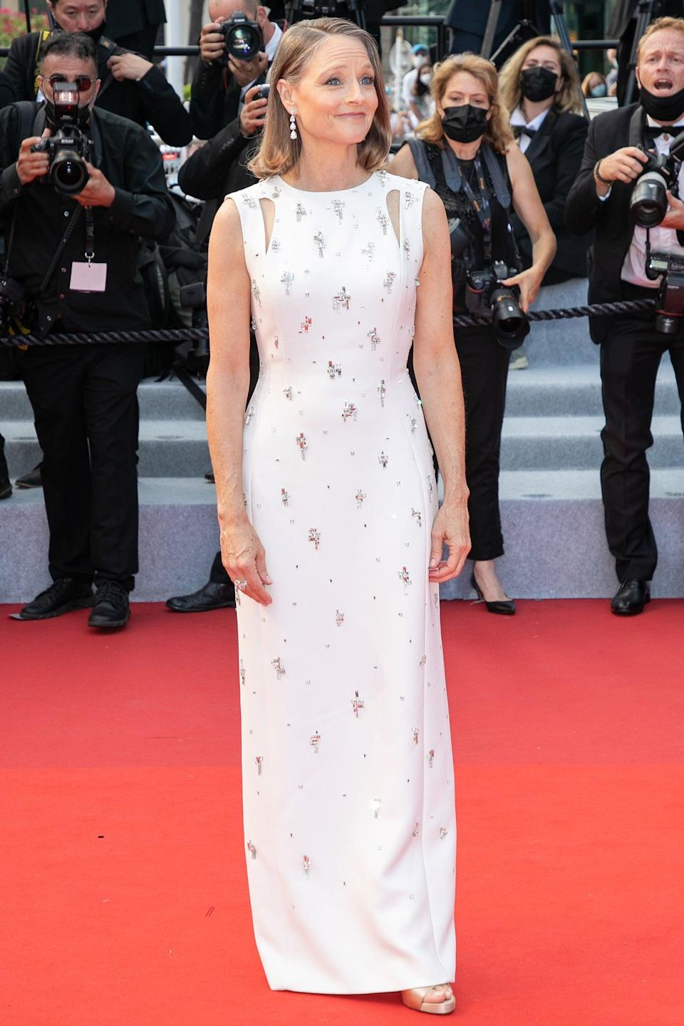 """Actress Jodie Foster did a subtle take on the cut-out trend in a white custom Givenchy gown with silver embellishments. <span class=""""copyright"""">Photo: Marc Piasecki/FilmMagic.</span>"""