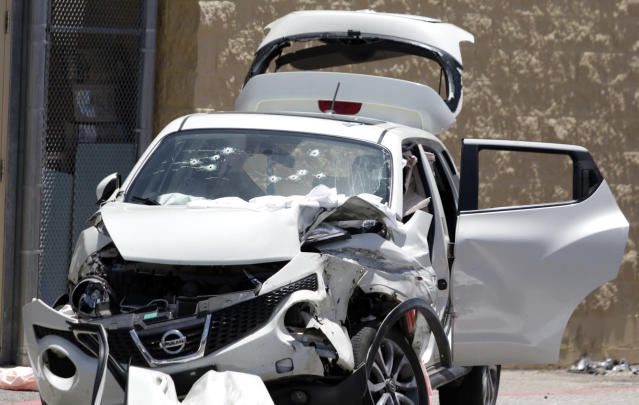 <p> A bullet ridden car is seen at a Walmart parking lot in Tallassee, Ala., Tuesday, June 19, 2018. A gunman crashed into the vehicle Tuesday morning, opening fire and killing two women before taking his own life, authorities said. (Emily Enfinger/Opelika-Auburn News via AP) </p>
