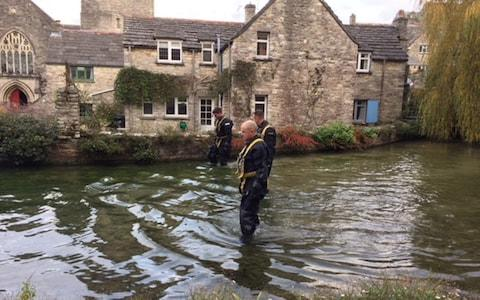A police team searches a mill pond in Swanage, Dorset, after 19-year-old Gaia Pope - Credit: Jennifer Cockerell/PA