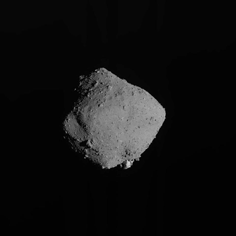 FILE - In this Nov. 13, 2019, file image released by the Japan Aerospace Exploration Agency (JAXA), shows asteroid Ryugu taken by Japan's Hayabusa2 spacecraft. The Japanese space agency said Friday they are all set for the spacecraft′s final approach to Earth this weekend to deliver a capsule containing valuable samples of a distant asteroid that could provide clues to the origin of the solar system. (JAXA via AP, File)