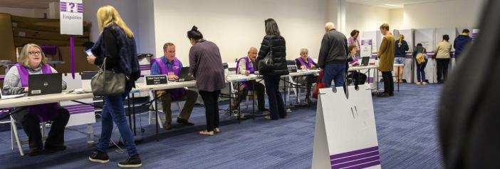 "<span class=""caption"">Australian voters check in and cast their ballots in a September 2019 federal election.</span> <span class=""attribution""><a class=""link rapid-noclick-resp"" href=""https://www.flickr.com/photos/auselectoralcom/48801171148/"" rel=""nofollow noopener"" target=""_blank"" data-ylk=""slk:Australian Electoral Commission"">Australian Electoral Commission</a></span>"
