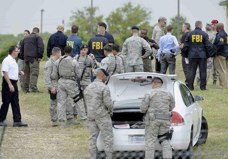 Military and law enforcement personnel are seen inside Lackland Air Force Base in San Antonio Texas