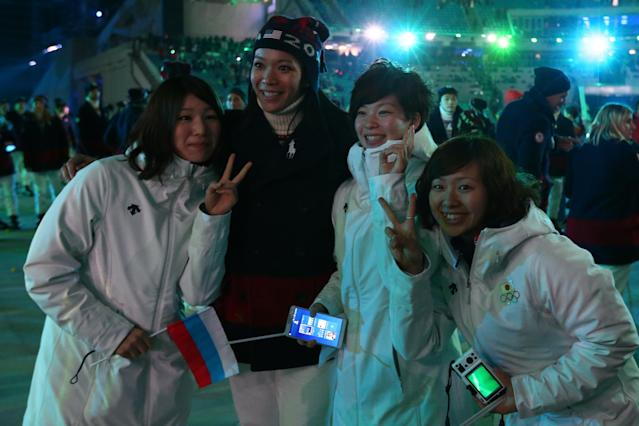 SOCHI, RUSSIA - FEBRUARY 23: A Julia Chu of the United States (2L) poses with Japanese athletes at the closing party after the 2014 Sochi Winter Olympics Closing Ceremony at Fisht Olympic Stadium on February 23, 2014 in Sochi, Russia. (Photo by Ryan Pierse/Getty Images)