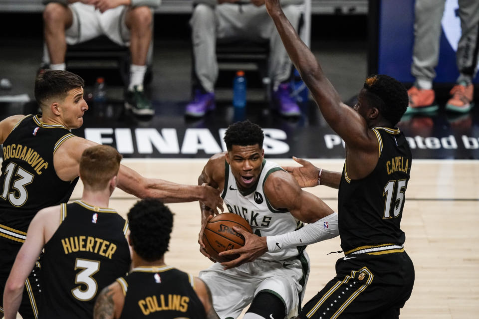 Milwaukee Bucks forward Giannis Antetokounmpo (34) defends the ball against the Atlanta Hawks during the second half of Game 4 of the NBA Eastern Conference basketball finals Tuesday, June 29, 2021, in Atlanta. (AP Photo/Brynn Anderson)