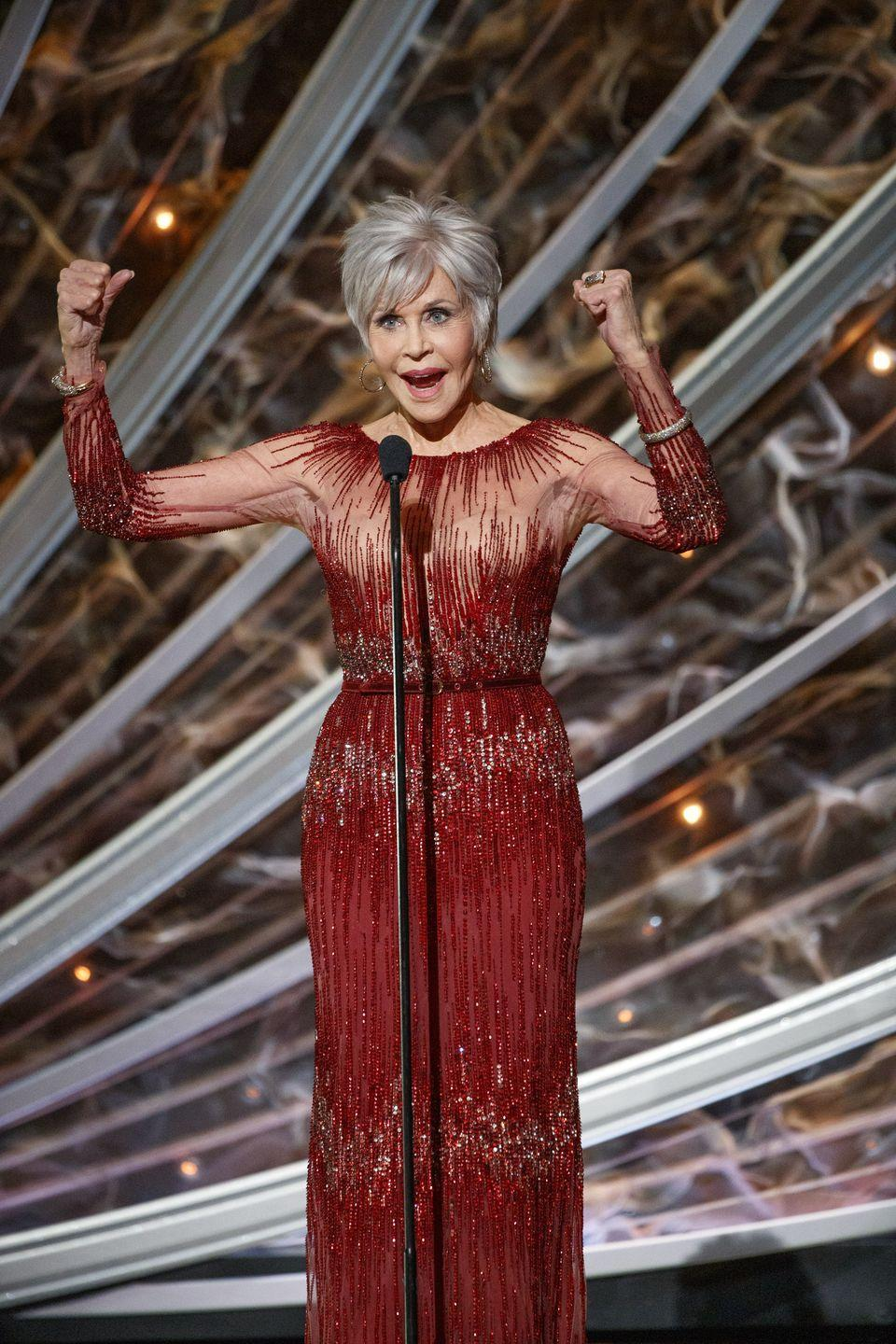 """<p>As part of her activism around climate change, Jane Fonda vowed that she would <a href=""""https://www.harpersbazaar.com/celebrity/latest/a29741997/jane-fonda-red-coat/"""" rel=""""nofollow noopener"""" target=""""_blank"""" data-ylk=""""slk:stop purchasing new clothing"""" class=""""link rapid-noclick-resp"""">stop purchasing new clothing</a>. And she appears to have stayed committed to that mission. At the 2020 Oscars, she wore <a href=""""https://www.wmagazine.com/story/jane-fonda-2020-oscar-dress-rewore-cannes/"""" rel=""""nofollow noopener"""" target=""""_blank"""" data-ylk=""""slk:a sparkling red dress that she'd previously worn to the Cannes Film Festival"""" class=""""link rapid-noclick-resp"""">a sparkling red dress that she'd previously worn to the Cannes Film Festival</a> in 2014. </p>"""