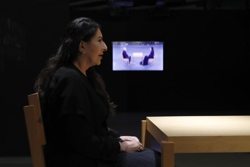 "Performance artist Marina Abramovic performs during the art exhibition ""Marina Abramovic - The Cleaner"" in the Museum of Contemporary Art in Belgrade, Serbia, Saturday, Sept. 21, 2019. Abramovic is displaying her work in her native Belgrade for the first time in 44 years and she says that returning home has been highly emotional. (AP Photo/Darko Vojinovic)"