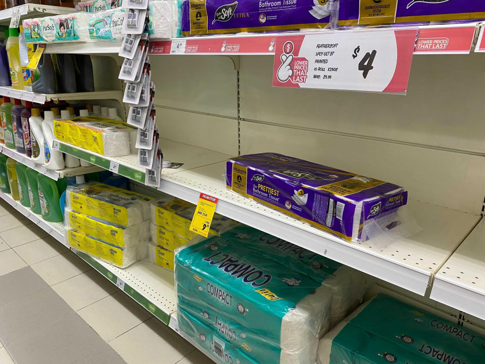 Shelves with reduced stocks of toilet paper are seen at a supermarket in Singapore, Friday, May 14, 2021. Singapore further tightened its COVID-19 measures as it sought to control an increase in untraceable coronavirus infections in the city-state. (AP Photo/Zen Soo)