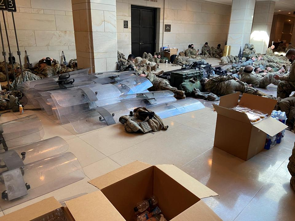 Riot shields are stockpiled in the Capitol where National Guard members rest Jan. 13.