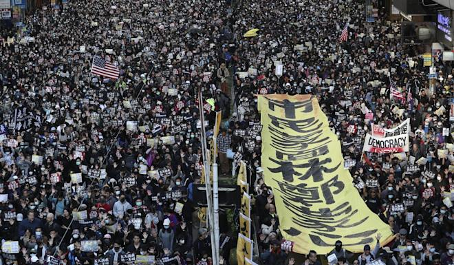 Anti-government protesters march from Causeway Bay to Central in Hong Kong on the eve of the six month anniversary of the movement. Photo: Robert Ng