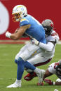 Tampa Bay Buccaneers outside linebacker Shaquil Barrett (58) sacks Los Angeles Chargers quarterback Justin Herbert (10) during the first half of an NFL football game Sunday, Oct. 4, 2020, in Tampa, Fla. (AP Photo/Mark LoMoglio)