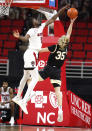 N.C. State's D.J. Funderburk (0) blocks the shot by Wake Forest's Carter Whitt (35) during the first half of an NCAA college basketball game Wednesday, Jan. 27, 2021, in Raleigh, N.C. (Ethan Hyman/The News & Observer via AP, Pool)