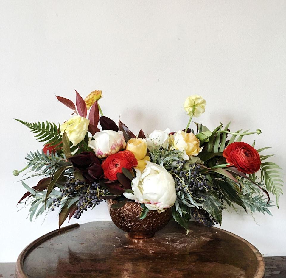 "<p>Energize your winter decor by sprinkling traditional reds and greens with citrus-inspired yellow and orange hues. This bright bouquet brings a unique color palette to an all-white table setting.</p><p><em>Via </em><a href=""http://www.bostonpollen.com/"" rel=""nofollow noopener"" target=""_blank"" data-ylk=""slk:Pollen"" class=""link rapid-noclick-resp""><em>Pollen</em></a></p>"