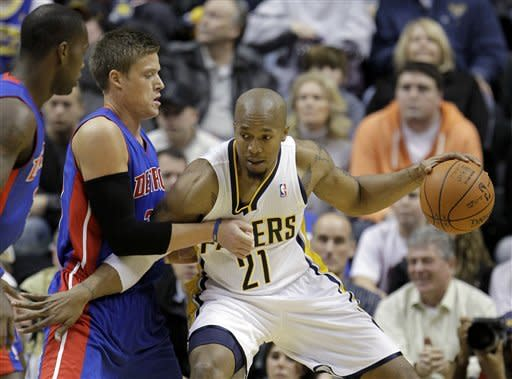 Indiana Pacers' David West, right, goes to the basket against Detroit Pistons' Jonas Jerebko during the first half of an NBA basketball game Monday, Dec. 26, 2011, in Indianapolis. (AP Photo/Darron Cummings)