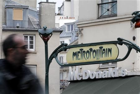 A Metro underground entrance is seen in front of a McDonald's fast-food restaurant in Paris