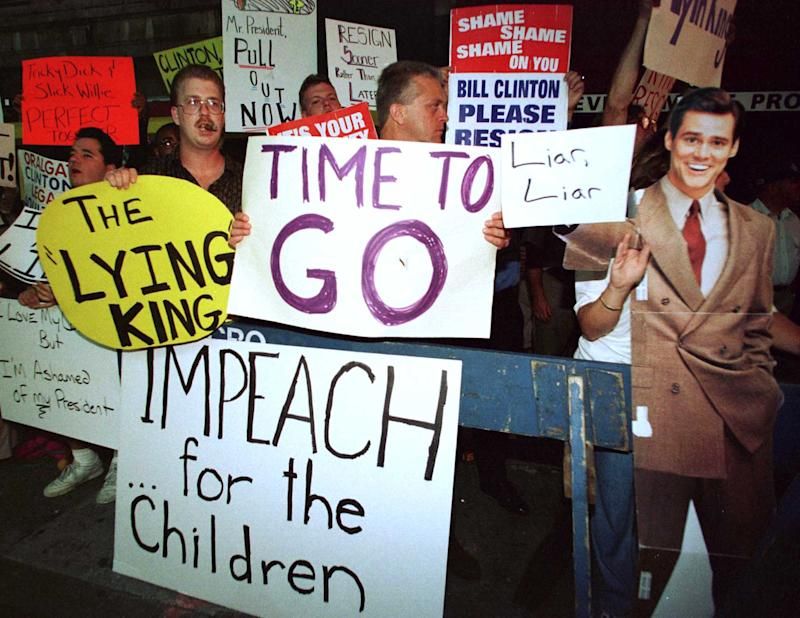 "A group of protesters yell and carry signs outside the theater in New York September 14, 1998 where President Bill Clinton was attending a Broadway show of ""The Lion King."" Several of the nations newspapers have also called on Clinton to resign in the wake of the Monica Lewinsky sex scandal. (Photo: Reuters)"