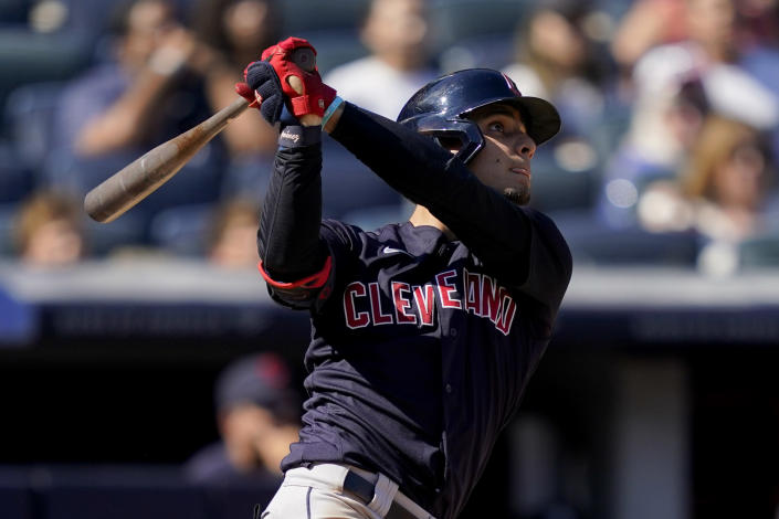 Cleveland Indians' Andres Gimenez hits a three-run home run off New York Yankees relief pitcher Albert Abreu in the fifth inning of a baseball game, Saturday, Sept. 18, 2021, in New York. (AP Photo/John Minchillo)