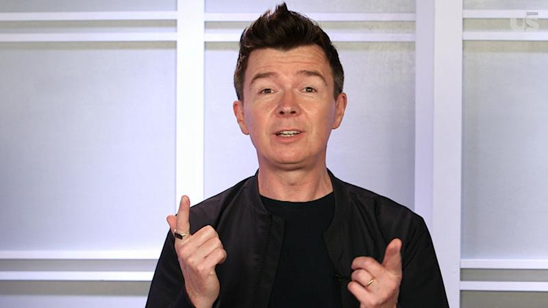 Rick Astley recently stopped by Us Weekly's NYC offices to teach a few lucky staff members how to sing his trademark 1987 hit 'Never Gonna Give You Up' — watch