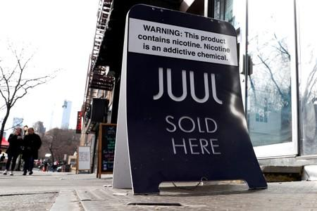 FILE PHOTO: A sign advertising Juul brand vaping products is seen outside a shop in Manhattan in New York City