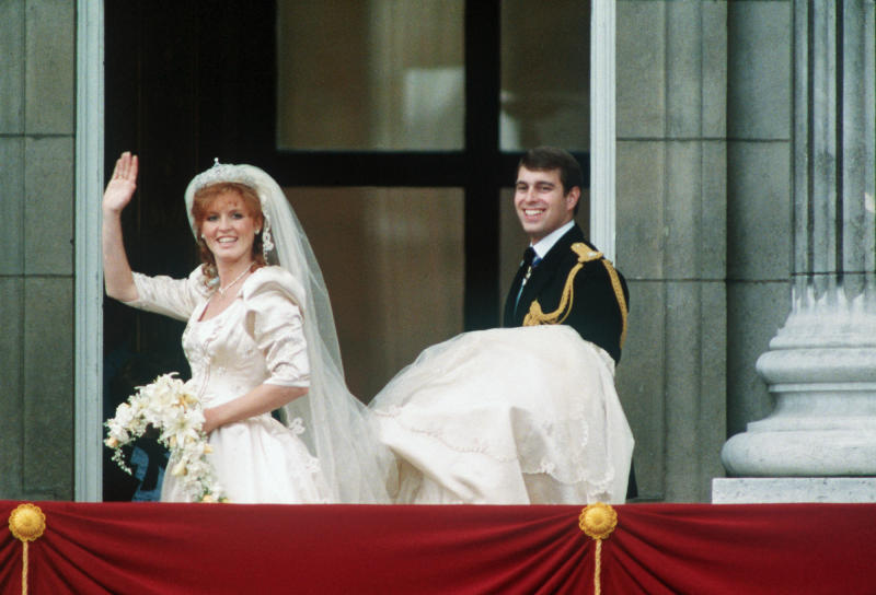 Sarah, Duchess of York, wore a satin dress by Lindka Cierach to her 1986 wedding to Prince Andrew. (Getty Images)